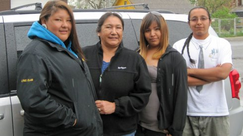 Standing in front of the support van that follows the walkers on their journey from Grassy Narrows First Nation to Toronto are (L-R) Jolene Hookimawillillene, Maryanne Swain (support van driver), Shanice Desrosiers, and Edmond Jack. Three of the walkers are not pictured.